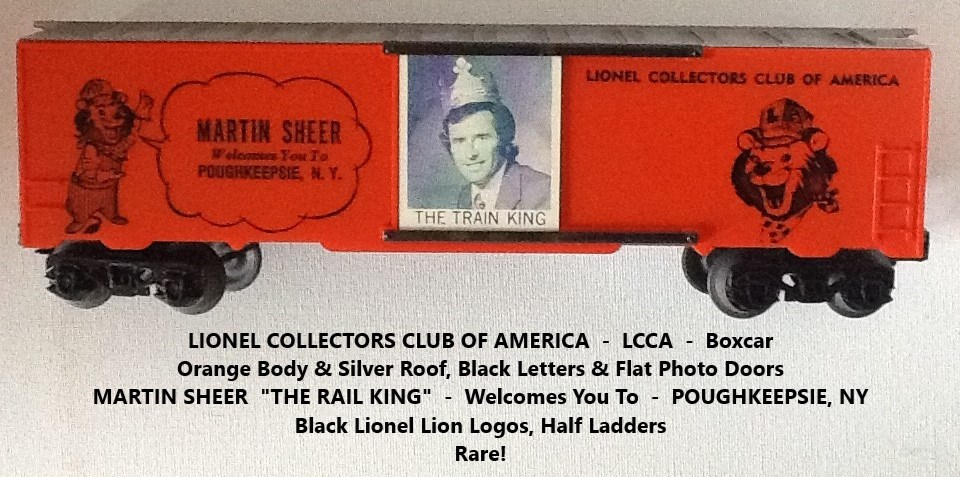 Kris LCCA orange and silver boxcar with black lettering