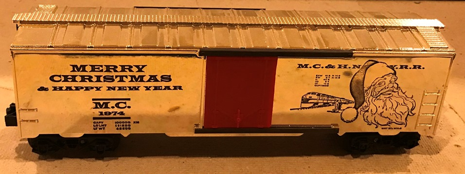 Kris 1974 gold holiday boxcar with black lettering