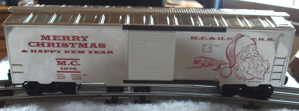 Kris 1974 gold holiday boxcar with white doors and red lettering