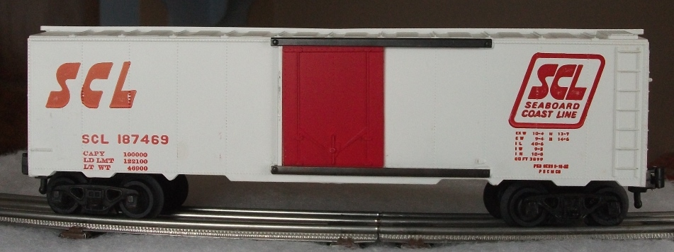 Kris Seaboard Coast Line 187469 white boxcar with red plug doors and full ladders