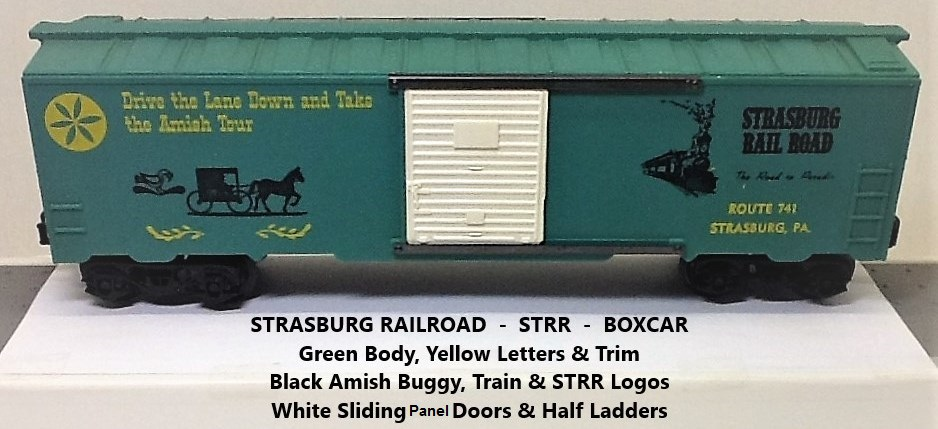 Kris Strasburg Rail Road green boxcar with yellow letters and panel doors