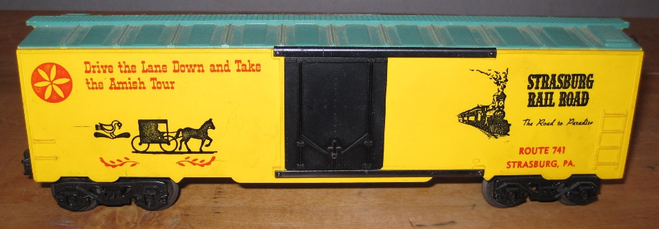Kris Strasburg Rail Road yellow and green boxcar with black doors